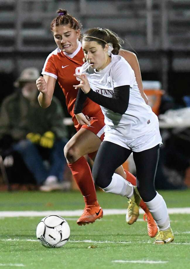 Jamesville-DeWitt's Lainey Foti (9) and Scotia's Tanya Leggiero (7) chase  the ball during a girls' Class A state regional high school soccer game in Stillwater, N.Y., Tuesday, Oct. 31, 2017. (Hans Pennink / Special to the Times Union) ORG XMIT: HP102 Photo: Hans Pennink / Hans Pennink