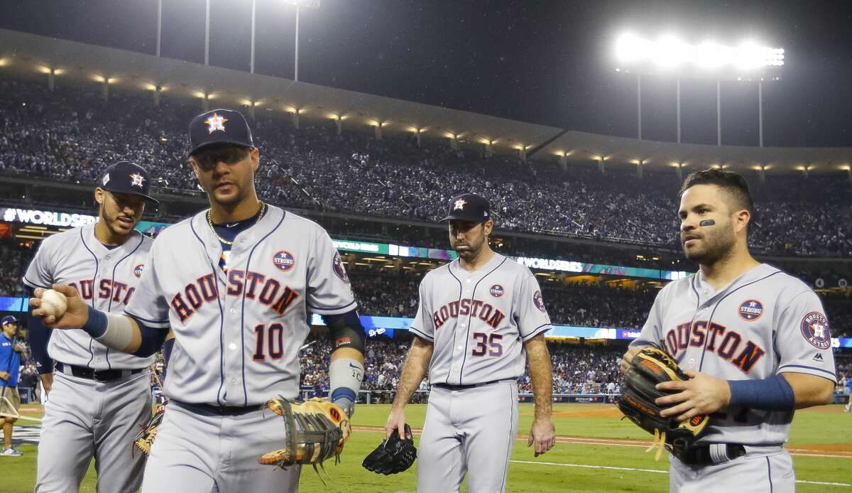 Houston Astros shortstop Carlos Correa (1), first baseman Yuli Gurriel (10), starting pitcher Justin Verlander (35) and second baseman Jose Altuve (27) walk off of the field during Game 6 of the World Series at Dodger Stadium on Tuesday, Oct. 31, 2017, in Los Angeles.