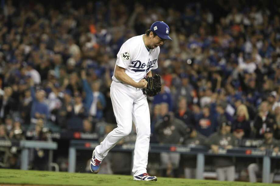 The Los Angeles Dodgers' Kenta Maeda celebrates after escaping a seventh-inning jam and holding a 2-1 lead against the Houston Astros during Game 6 of the World Series on Tuesday, Oct. 31, 2017, at Dodger Stadium in Los Angeles. (Robert Gauthier/Los Angeles Times/TNS) Photo: Robert Gauthier / TNS / Los Angeles Times