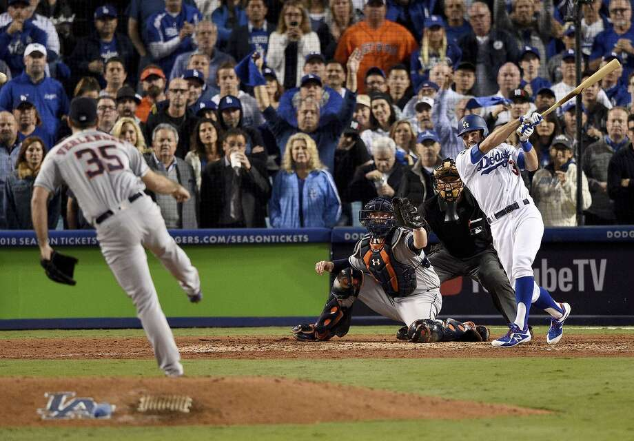 The Dodgers' Chris Taylor connects for an RBI double off Astros starter Justin Verlander to tie the score in the sixth inning. Corey Seager followed with a go-ahead sacrifice fly. Photo: Kevork Djansezian / Kevork Djansezian / Getty Images / 2017 Getty Images