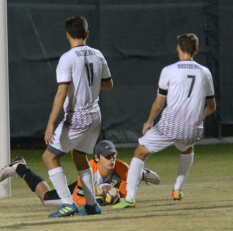 The UTPB goal keeper saves the ball as Elias Perales and Michael Iskander close in for the Dustdevils, Tuesday, October 31, 2017. Photo: Cuate Santos /Laredo Morning Times File / Laredo Morning Times