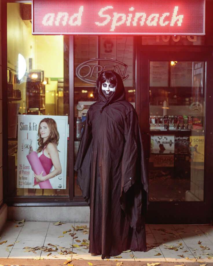 Ken Powers poses as Death on Halloween in Capitol Hill on Tuesday, Oct. 31, 2017. Photo: GRANT HINDSLEY, SEATTLEPI.COM / SEATTLEPI.COM