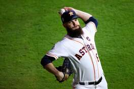 HOUSTON, TX - OCTOBER 29:  Dallas Keuchel #60 of the Houston Astros warms up before game five of the 2017 World Series against the Los Angeles Dodgers at Minute Maid Park on October 29, 2017 in Houston, Texas.  (Photo by Ezra Shaw/Getty Images)