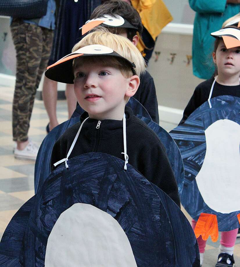 Happy penguins Jack Brennan and Catherine Schernecke take part in the Holly Pond School parade held Tuesday, Oct. 31 in Darien, Conn. Photo: Darien News / Contributed Photo / Darien News