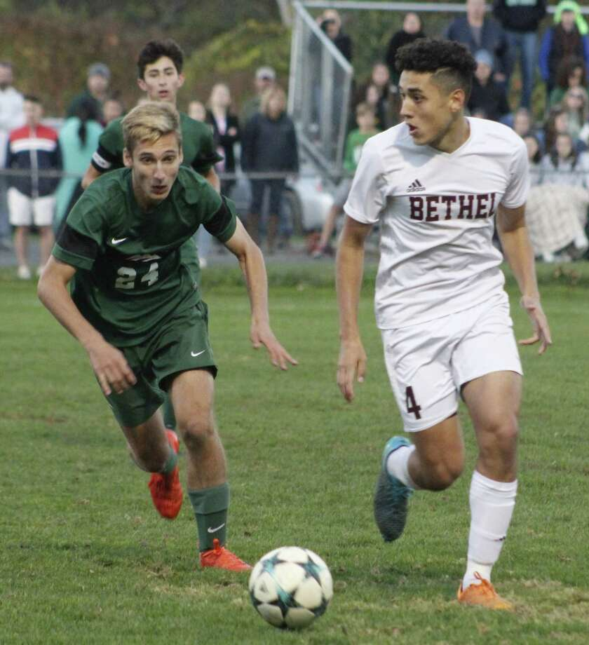 Bethel's Gabriel Carrijo, right, looks for an opening as New Milford's Chase Schuster defends during the South-West Conference quarterfinal boys soccer game at Rourke Field in Bethel on Oct. 27. Photo: Richard Gregory / Hearst Connecticut Media