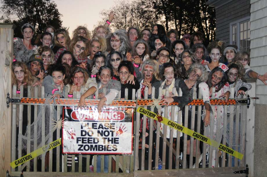 """For the second year, women in Fairfield dressed as zombies performed a  choreographed dance to Michael Jackson's Thriller on Halloween night  2017. The MOMbies, as they are called, raised nearly $3,000 online to  benefit cancer research. """"We dedicate this  project to a dear friend and fellow MOMbie, as well as to all of the  special people in each of our lives,"""" their CrowdRise.com page states.  Were you SEEN as a MOMbie? Photo: Stacey Scruggs"""