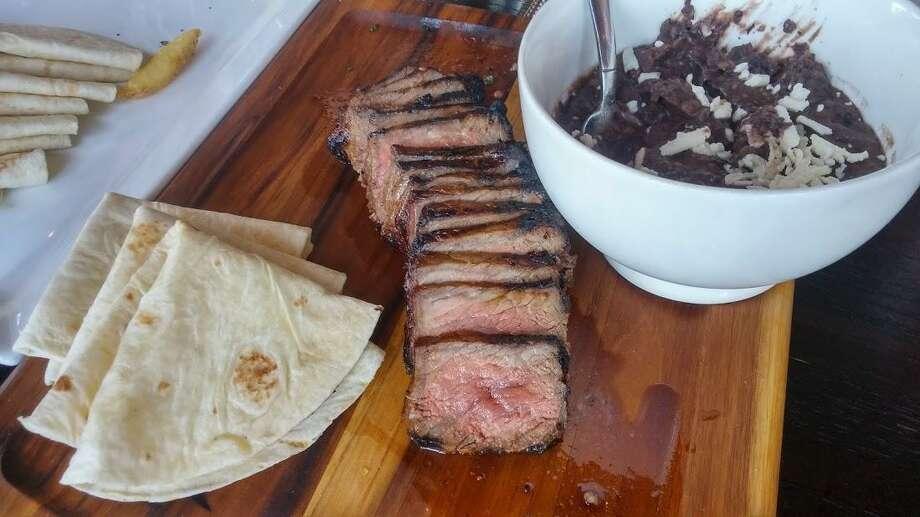 Strip steak for carne rancheros. Photo: Frank Whitman / For Hearst Connecticut Media