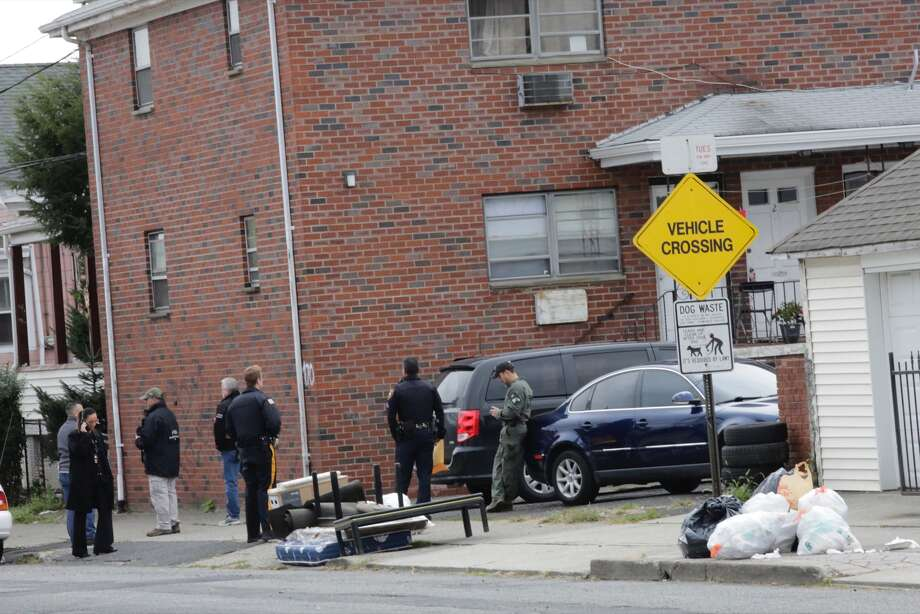 FBI officers and New Jersey police officer walk outside of suspect Sayfullah Saipovs apartment, on November 1, 2017, in Paterson, New Jersey.  A pickup driver killed eight people in New York on Tuesday, mowing down cyclists and pedestrians before striking a school bus, in the city's first deadly attack blamed on terror since September 11, 2001.Law enforcement sources identified the perpetrator as Sayfullo Saipov, 29. He was arrested in Missouri on a traffic fine last year.The Uzbek citizen living in Tampa, Florida had recently been staying in New Jersey, where the truck was rented, reports said. Photo: EDUARDO MUNOZ ALVAREZ/AFP/Getty Images