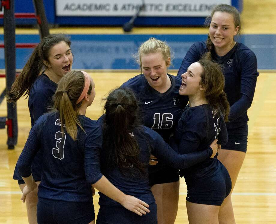College Park players celebrate after a point by right side hitter Annie Cooke (16) during the third set of a Region II-6A bi-district volleyball match at Leon High School, Tuesday, Oct. 31, 2017, in Jewett. Photo: Jason Fochtman/Houston Chronicle