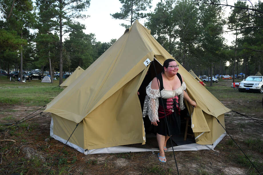 Melissa Puente, of San Antonio, checks out a visitor to her tent while camping with her husband Henry in the new Glamalot camping area at the Texas Renaissance Festival. Photo: Jerry Baker, Freelance / Freelance