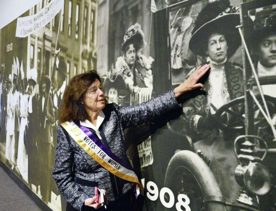 Coline Jenkins ofGreenwich, Conn., points out her great grandmother suffragette Nora Stanton Blatch in a photo mural during a special exhibition preview of the State Museum's newest exhibition honoring the 100th anniversary of women's right to vote in New York at the NY State Museum Wednesday Nov. 1, 2017 in Albany, NY.  (John Carl D'Annibale / Times Union) Photo: John Carl D'Annibale, Albany Times Union / 20041964A