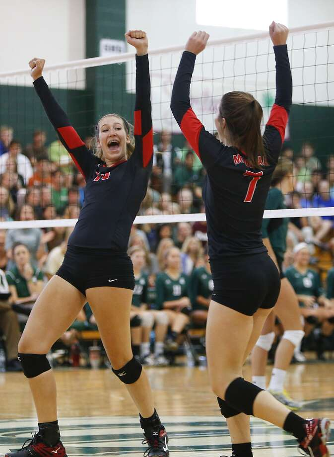 Meredith Philips of Memorial celebreates a point with teammate Gillian Koskie as the Lady Mustangs took on Stratford as the two teams faced off in Match 1 of 2 at Stratford High School on August 25, 2015. Photo: Diana L. Porter, Freelance / © Diana L. Porter