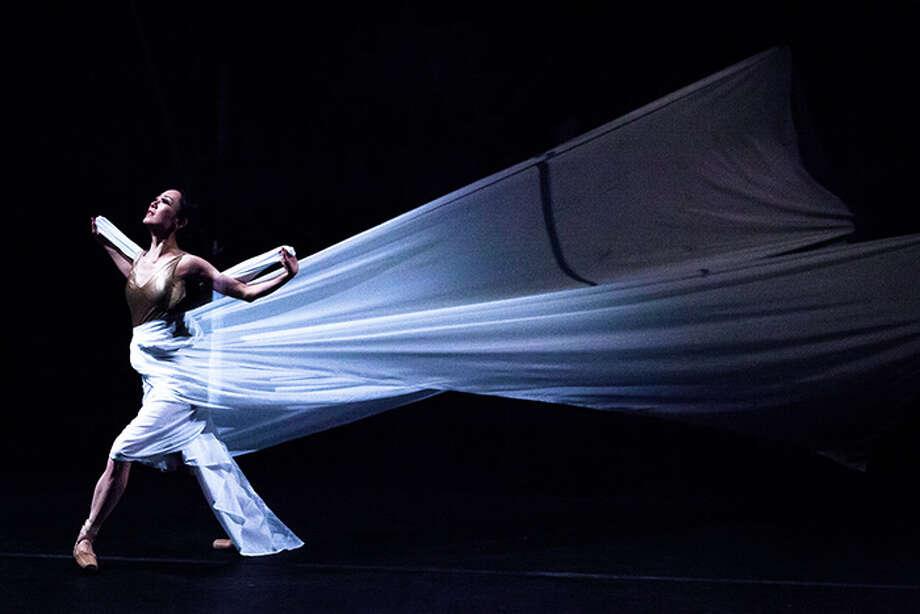 "Former Houston Ballet soloist Nao Kusuzaki stars in ""Tsuru,"" a contemporary dance based on the Japanese folk tale ""The Crane Wife,"" presented by Asia Society Texas Center. Photo: Lynn Lane / Lynn Lane"