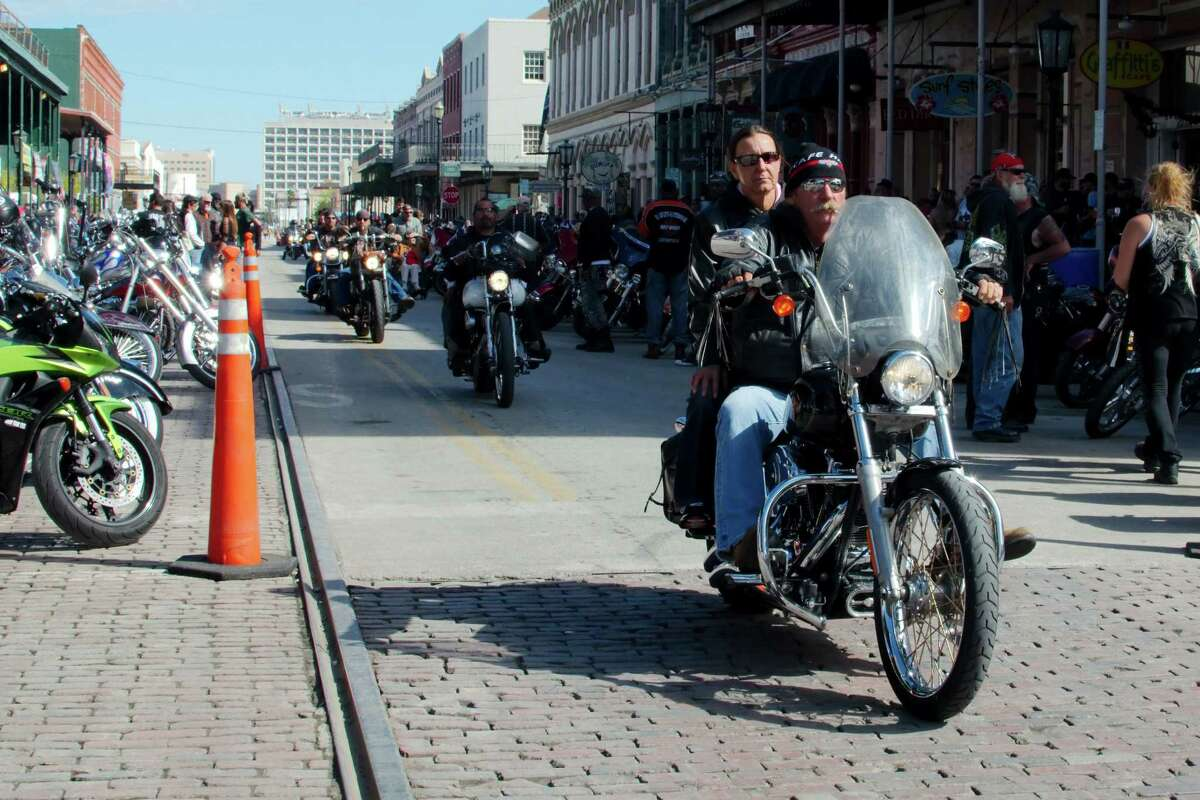 Riders participate in the bike parade down the streets of the Historic Strand district in downtown Galveston during the Lone Star Rally.