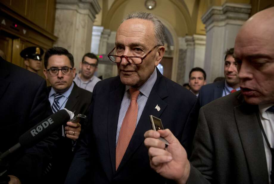 """Senate Minority Leader Sen. Chuck Schumer of N.Y., speaks with reporters as he leaves a news conference on American labor on Capitol Hill in Washington, Wednesday, Nov. 1, 2017, Trump said on Twitter that the driver in Tuesday's attack """"came into our country through what is called the 'Diversity Visa Lottery Program,' a Chuck Schumer beauty"""" � a reference to the Senate's Democratic leader. (AP Photo/Andrew Harnik) Photo: Andrew Harnik, Associated Press"""