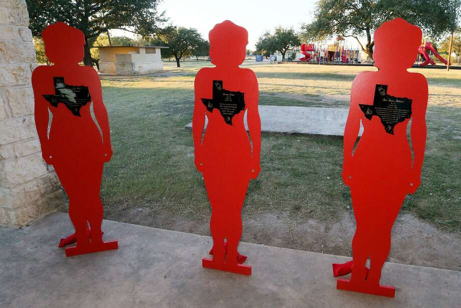 Three of fifteen Silent Witnesses stand at a Candelight Vigil at Pickrell Park in Schertz for domestic abuse month to honor women who have died from such abuse on Wednesday, Oct. 25, 2017. MARVIN PFEIFFER/mpfeiffer@express-news.net Photo: Marvin Pfeiffer, Staff / San Antonio Express-News / Express-News 2017