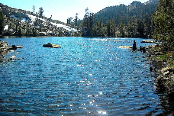 From the shore of the pay-off lake in the Granite Chief Wilderness, which abuts an area proposed for a 13,000-foot gondola to connect Squaw Valley and Alpine Meadows ski areas at north Tahoe