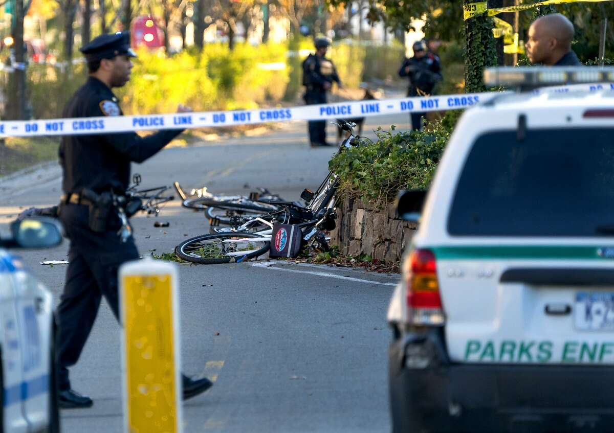 Bicycles and debris lay on a bike path after a motorist drove onto the path near the World Trade Center memorial, striking and killing several people Tuesday, Oct. 31, 2017. (AP Photo/Craig Ruttle)