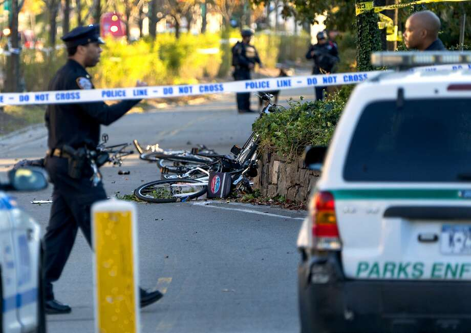 Bicycles, including some with the blue and orange logo of Blazing Saddles, are scattered Tuesday after a truck was driven onto a bike path in Manhattan. Photo: Craig Ruttle, Associated Press