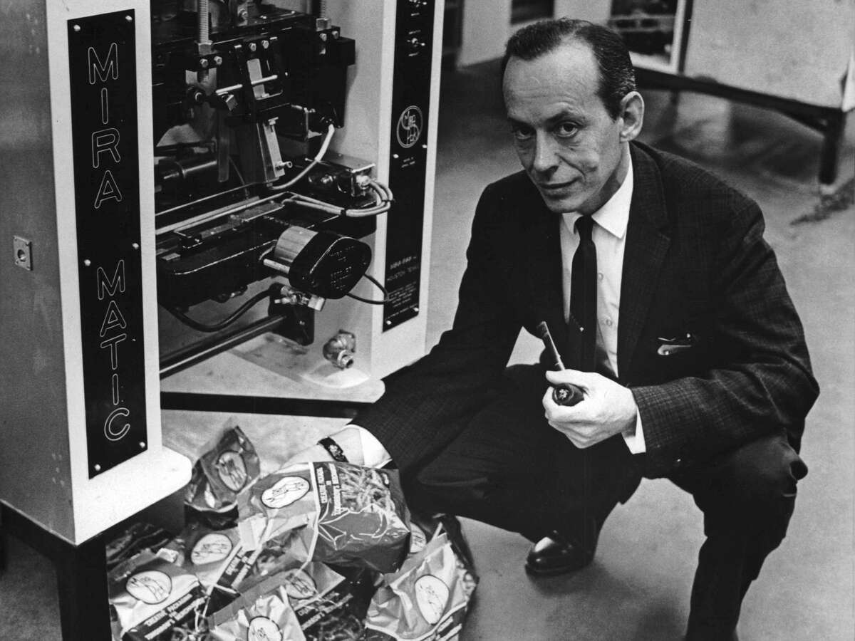 Inventor William C. Leasure with some sample bags formed, filled and sealed by the Mira-Matic, the automatic packaging machine his company, Mira-Pak Inc., manufactures for the snack food industry.