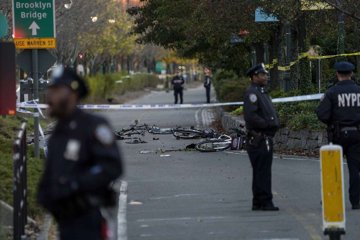 Bicycles and debris lie on a bike path after a motorist drove onto the path near the World Trade Center memorial, striking and killing several people Tuesday, Oct. 31, 2017, in New York. (AP Photo/Craig Ruttle)