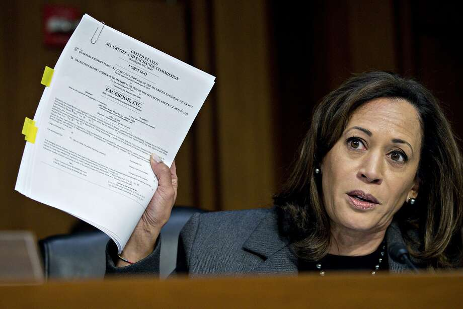 Sen. Kamala Harris holds up a Securities and Exchange Commission filing for Facebook Inc. while questioning witnesses during a Senate Intelligence Committee hearing. Photo: Andrew Harrer, Bloomberg