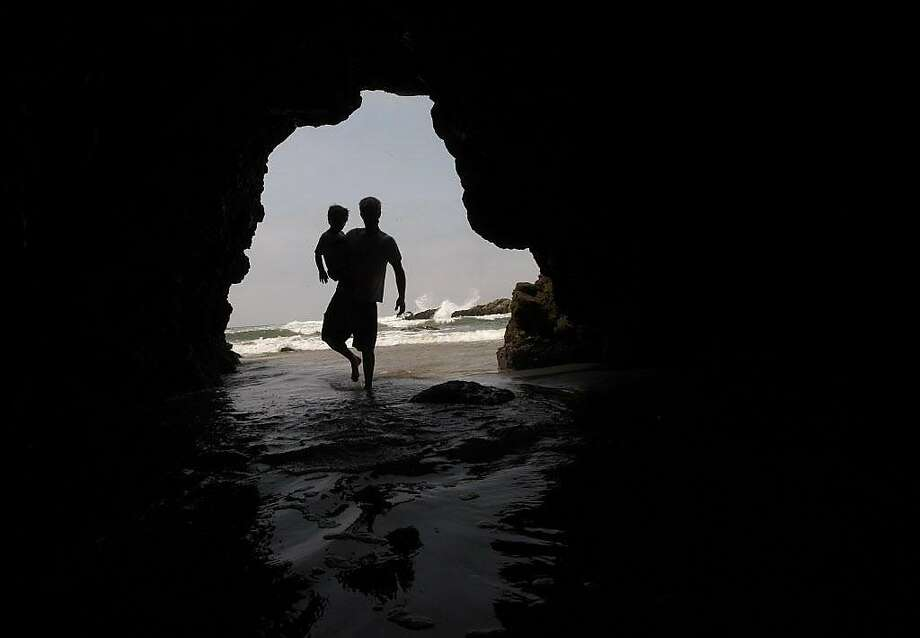 David Sleeth of Menlo Park started coming to Pescadero Beach with his parents years ago, and with a family of his own in 2007 he took his two boys to the same place. Photo: Michael Macor / The Chronicle 2007