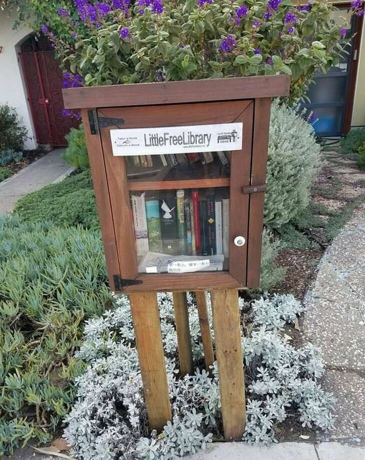 FILE-- Pictured is the Little Free Library in Outer Sunset, one of many locations in San Francisco. On Sunday morning, the Little Free Library on Castanada Avenue located in Forest Hill was defaced with box cutters and knocked off its perch. Photo: Photo By Meg T. On Yelp