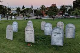 San Francisco resident Evan Hynes built a graveyard to defunct startups in Mission Dolores Park on Wednesday, Oct. 31, 2017.