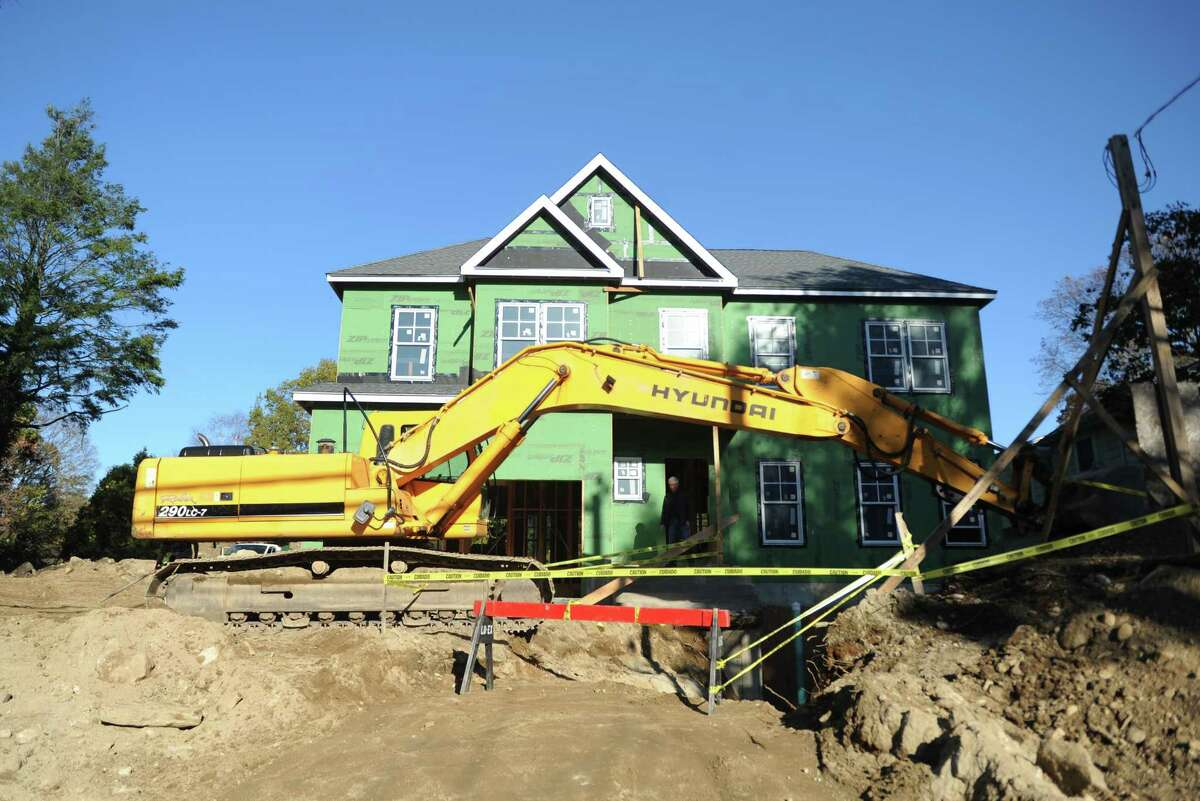 A home undergoes construction on Sound Beach Avenue in Old Greenwich, Conn. Tuesday, Oct. 31, 2017.
