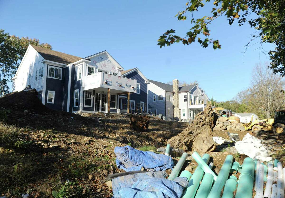 A home undergoes construction on Lockwood Lane in the Riverside section of Greenwich, Conn. Tuesday, Oct. 31, 2017.