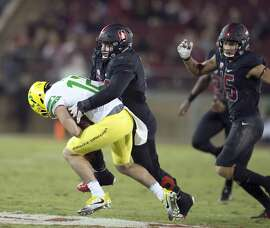 Stanford's Harrison Phillips (66) sacks Oregon's quarterback Taylor Alie (12) during the fourth quarter of an NCAA college football game, Saturday, Oct. 14, 2017, in Stanford, Calif. Stanford won 49-7. (AP Photo/D. Ross Cameron)