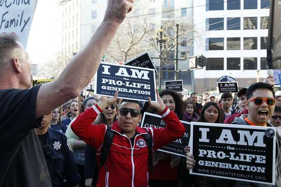 Antiabortion demonstrators participating in the Walk for Life march yell at pro-choice protesters (left) at Fifth and Market streets in San Francisco, Calif. on Saturday, Jan. 24, 2015.