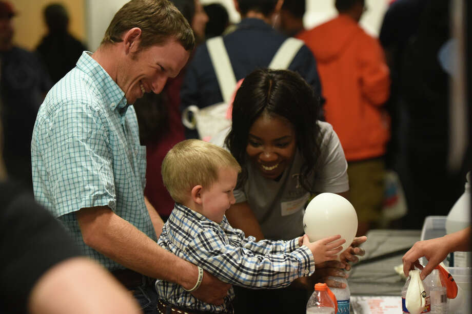 Families participate in interactive activities with volunteers from Texas Tech Health Sciences during a spooky science themed Family Science Night Oct. 31, 2017, at the Petroleum Museum. James Durbin/Reporter-Telegram Photo: James Durbin