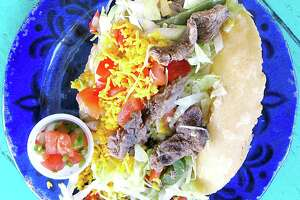 Taco of the Week: Beef fajita puffy taco with peppers, onions, lettuce, tomatoes and cheese on a handmade masa shell from Taco House.
