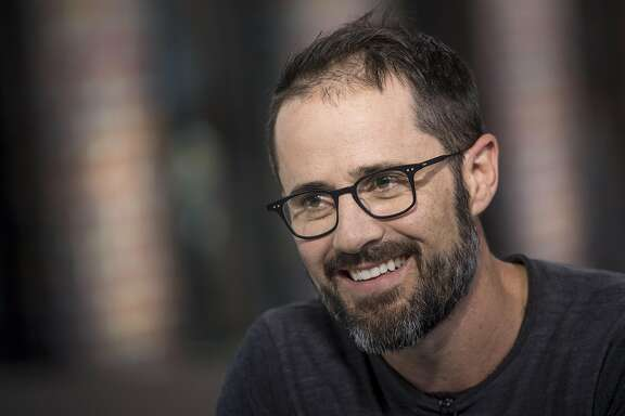 """Evan """"Ev"""" Williams, co-founder of Twitter Inc. and co-founder and chief executive officer of Medium.com, smiles during a Bloomberg West Television interview in San Francisco, California, U.S., on Tuesday, Aug. 30, 2016. Williams discussed the use of social media by presidential candidates, the growing concerns surrounding online harassment and the future of Twitter. Photographer: David Paul Morris/Bloomberg"""