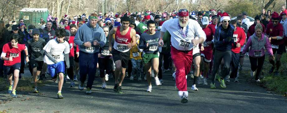 File photo of the 'Run, Santa Run' Photo: Contributed Photo / Contributed Photo / The News-Times Contributed