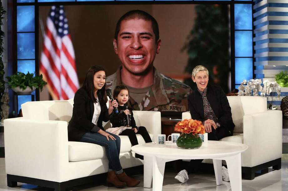 National TV host Ellen DeGeneres surprises a tearful military mom and her excited daughter from San Antonio with a video reunion with their husband and dad who's stationed in South Carolina. Photo: Courtesy Of Michael Rozman /Warner Bros. /Michael Rozman /Warner Bros. / Michael Rozman/Warner Bros.