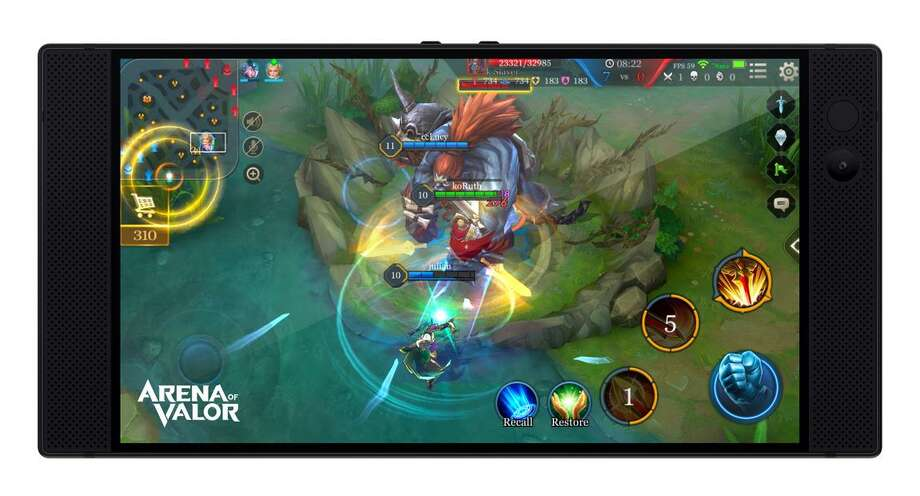 """""""Arena of Valor,"""" above, is one the games that will be available on Razer's smartphone when it hits the market Nov. 17. Razer CEO Min-Liang Tan, left, seen last year, unveiled the phone Wednesday. Photo: Photo Courtesy Of Razer / Photo Courtesy Of Razer"""