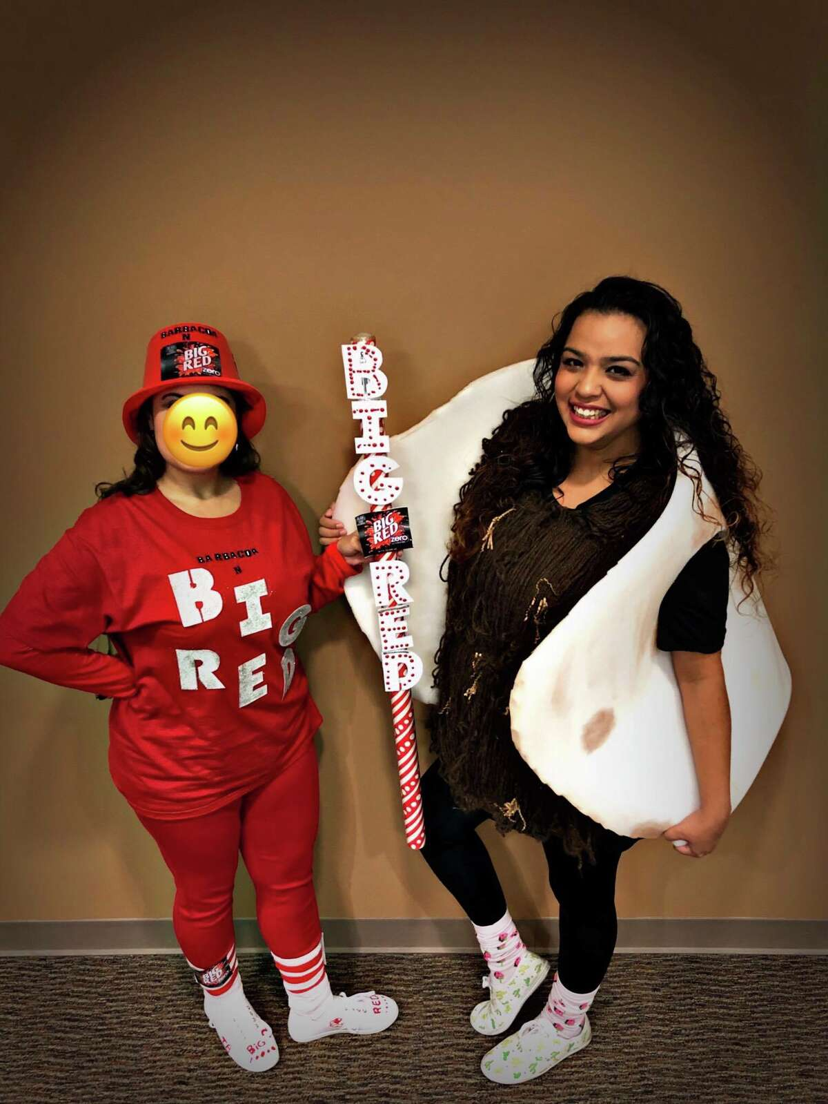 Erika De Anda and her coworker at The San Antonio Orthopedic Group dressed as Big Red & Barbacoa.