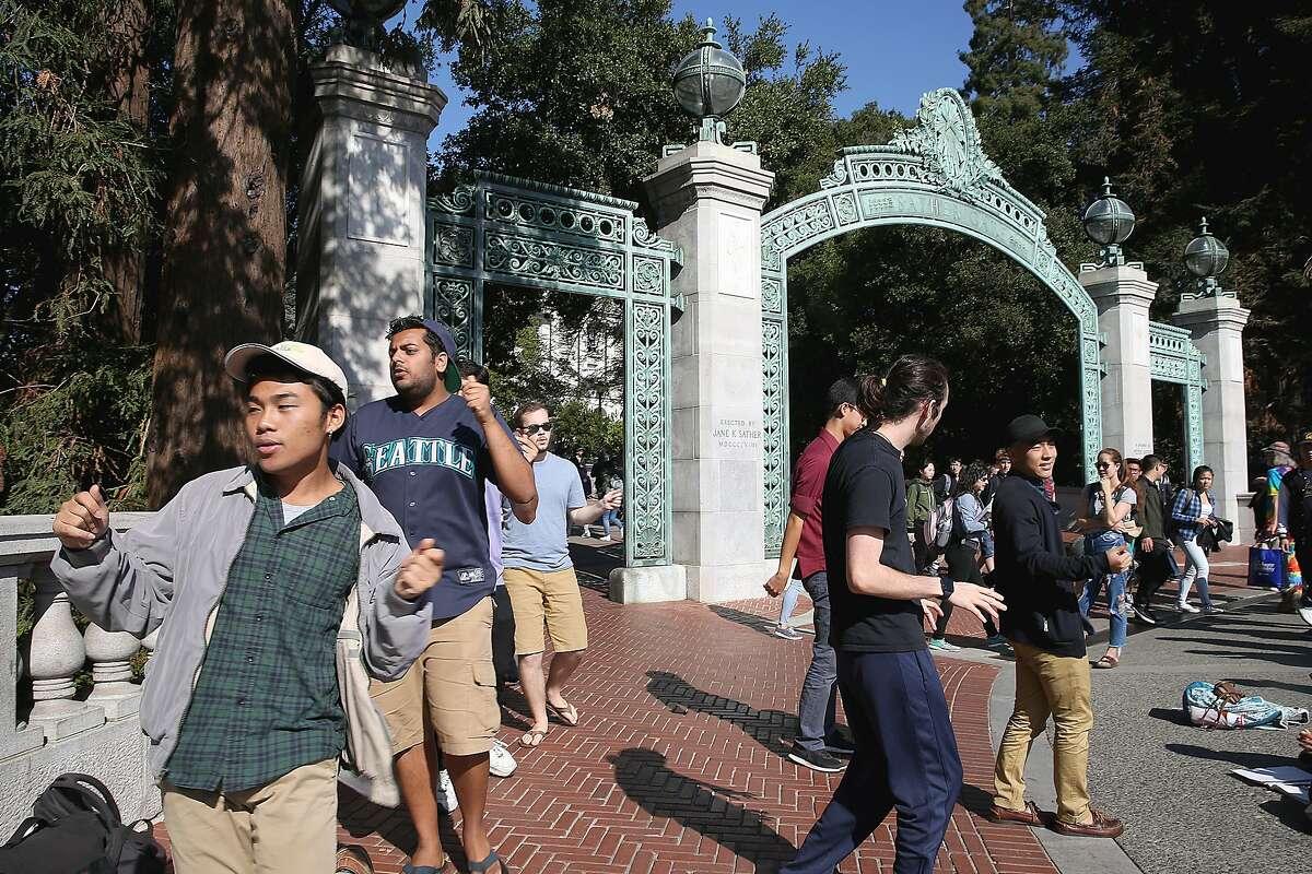 UC Men's Octet sing next to Sather Gate at UC Berkeley on Wednesday, November 1, 2017, in Berkeley, Calif.