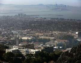 UC Berkeley campus seen in foreground with San Francisco skyline in background on Wednesday, November 1, 2017, in Berkeley, Calif..