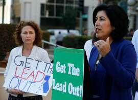 Oakland Unified School Board member Roseann Torres speaks at a news conference by local groups in Oakland, Calif. on Wednesday, Nov. 1, 2017 to launch a new campaign to remove lead from drinking water at Oakland schools. Also attending the news conference is Jean Shanley (left), of CALPIRG.