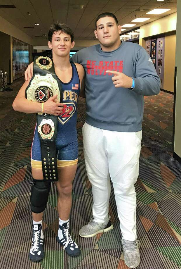 Danbury native Jakob Camacho, left, with coach Khaled Dassan after claiming the Super 32 National Championship in the 126-pound weight division last weekend. Photo: Contributed / Photo