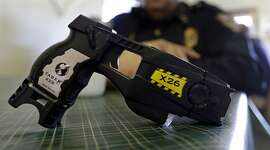 FILE - This Nov. 14, 2013, file photo, shows a Taser X26 on display. Shares in Axon Enterprises, the maker of Taser stun guns, have fallen more than 6 percent after the company admitted it had not replied to Securities and Exchange Commission inquiries due to �miscommunication issues.� In a filing with the SEC on Thursday, Oct. 19, 2017, Axon said it had just become aware of the inquiries from the agency and was working to resolve the matter. (AP Photo/Michael Conroy, File)