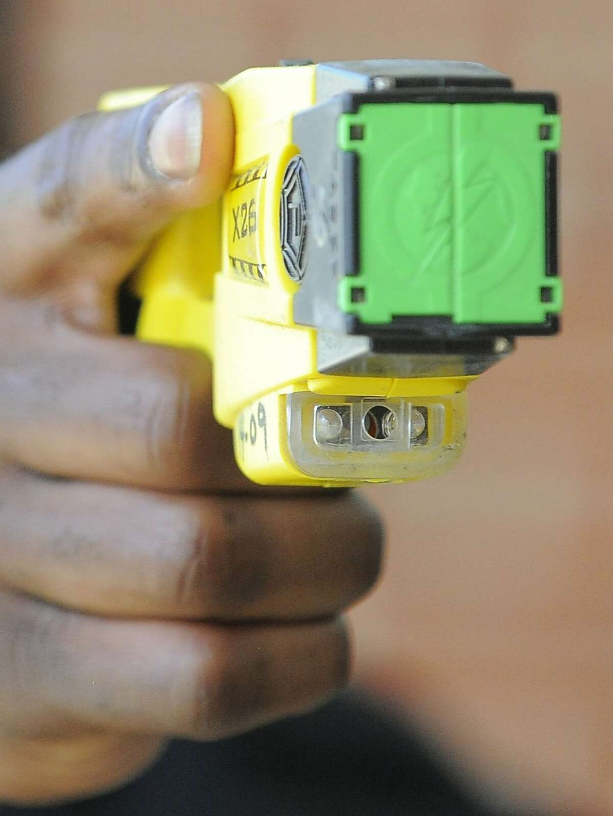 A Stamford Police Officer holds a Taser X26 Stun Gun on April 1, 2016. Blacks and Hispanics are shot with stun guns more often in Connecticut, while whites are given the benefit of a warning far more often, a Hearst review of state data from 2015 shows. Stamford police, however, only shot three people with a stun gun last year.