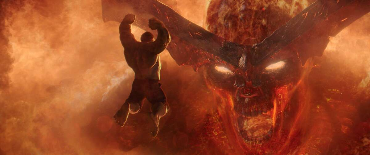 The Hulk (Mark Ruffalo) does battle with the fire demon (Clancy Brown).