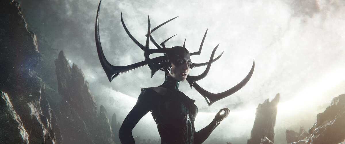 At left: Brothers in arms, Thor (Chris Hemsworth, left) and Loki (Tom Hiddleston). But who knew they had a sister? Not them, but Hela (Cate Blanchett, above) is not in a good mood after being held in captivity by their father.