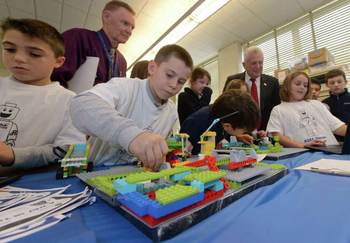 All Saints Catholic School students including Zachary Diiorio and Chris Uva participate in the second year of a First Lego Robotics team challenge Wednesday, November 1, 2017, where Norwalk Mayor Harry Rilling judges the projects that were designed to conserve water and select a winner at the school in Norwalk, Conn.