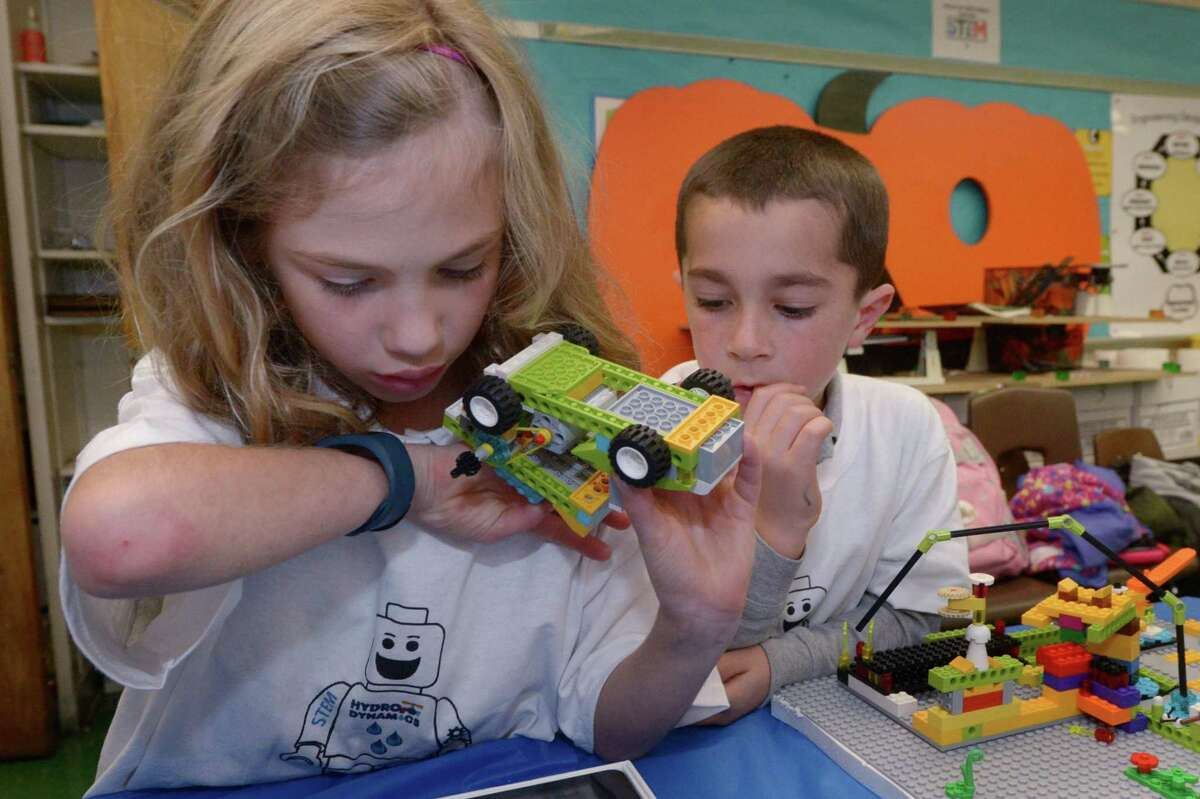 All Saints Catholic School students including first graders Maddy Conron and Cody Diiorio participate in the second year of a First Lego Robotics team challenge Wednesday, November 1, 2017, where Norwalk Mayor Harry Rilling judges the projects that were designed to conserve water and select a winner at the school in Norwalk, Conn.